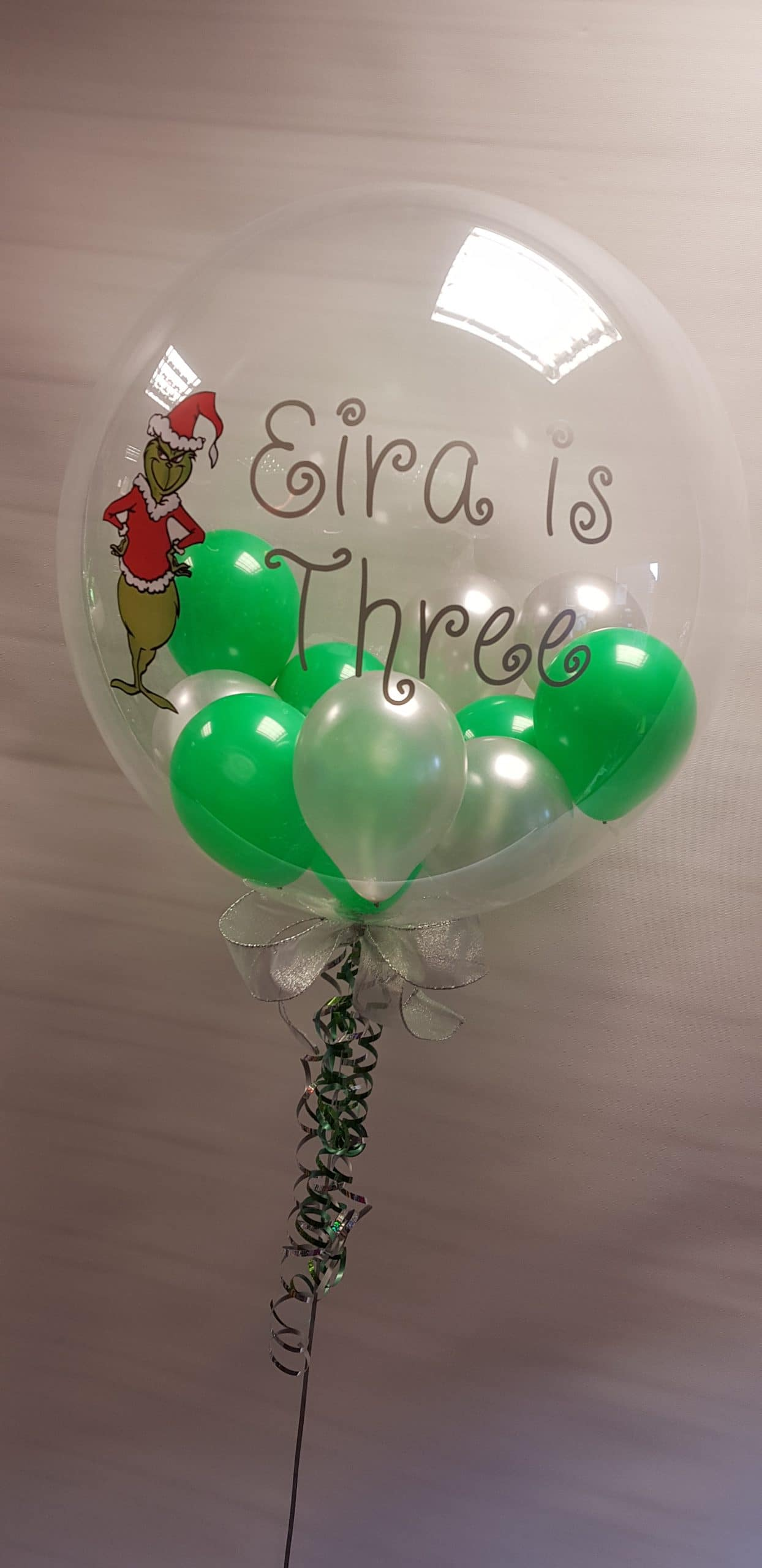 Personalised Grinch bubble available from Cardiff Balloons
