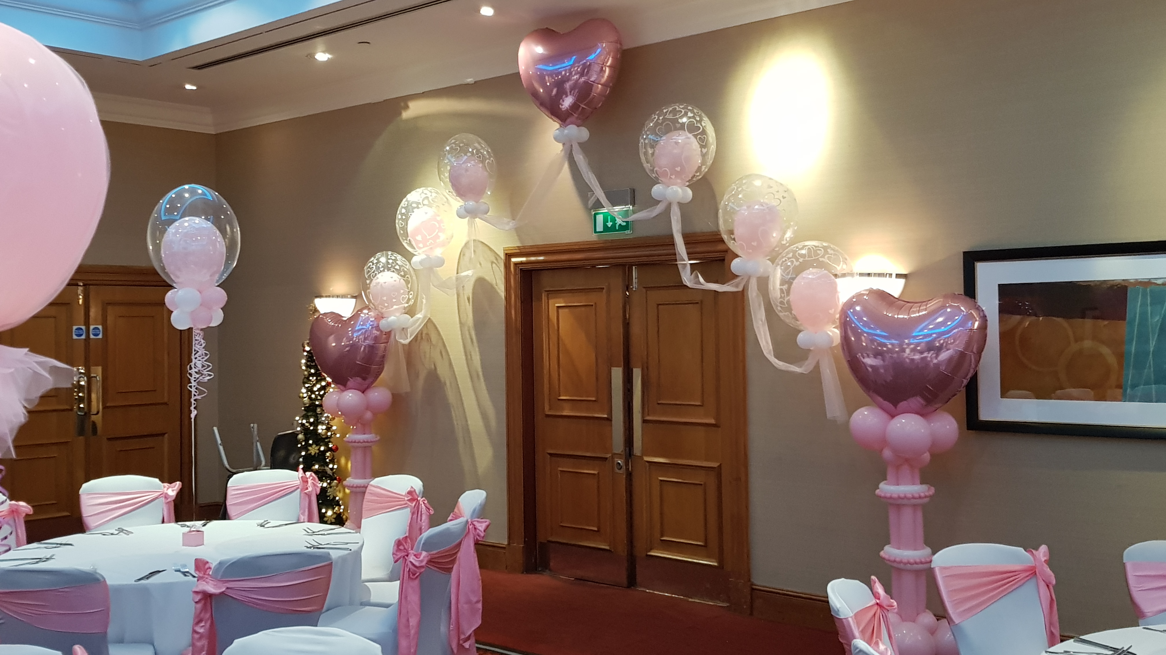 Pink & white double bubble arch available from Cardiff Balloons