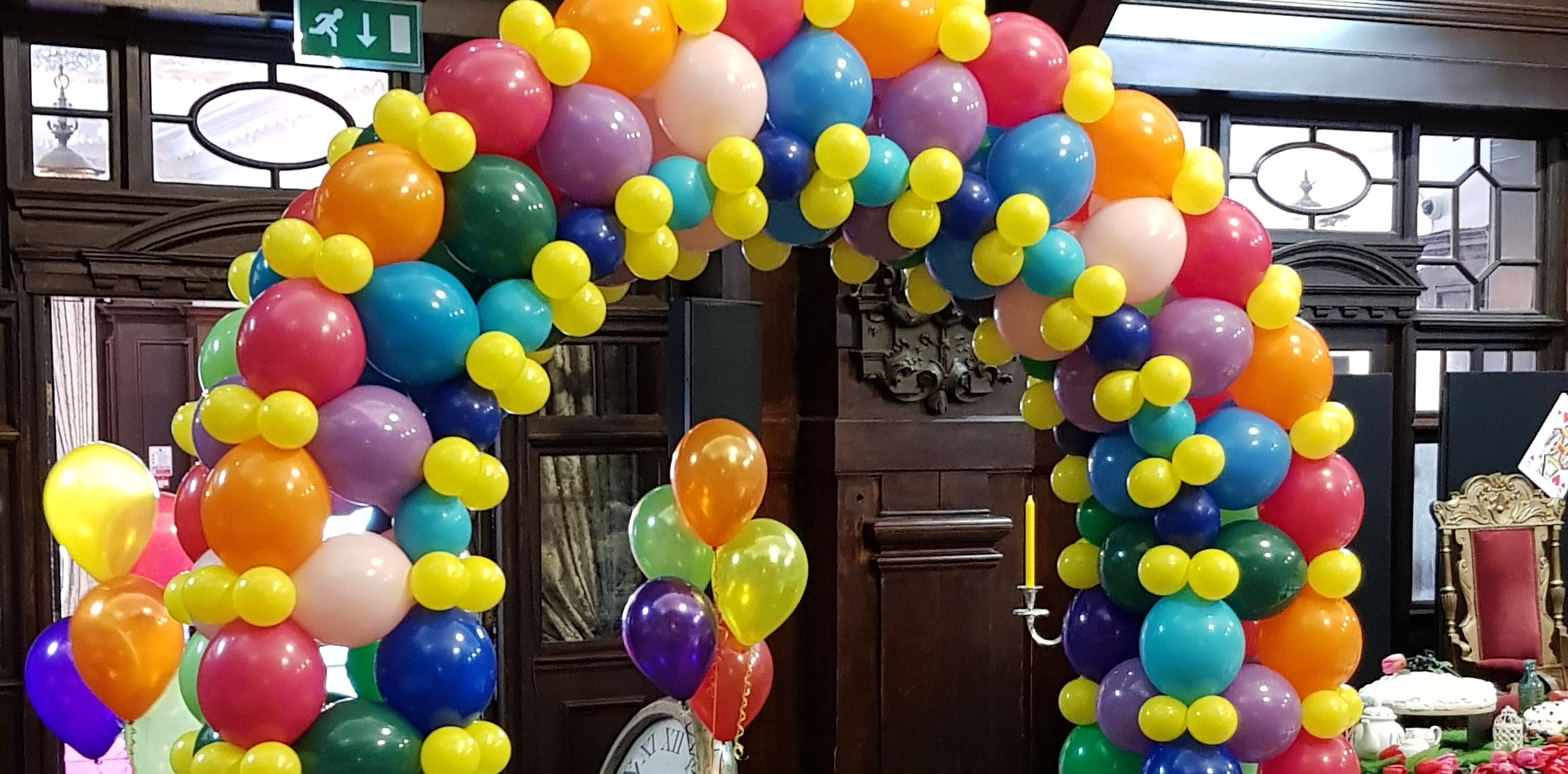 Multicoloured entrance arch available from Cardiff Balloons