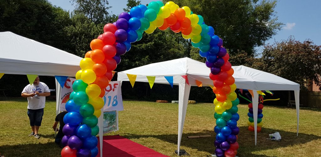 Rainbow spiral arch available from Cardiff Balloons