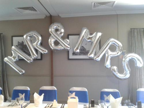 Giant Foil Letters Spelling MR & MRS. From Cardiff Balloons