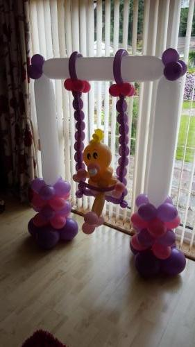 Baby On a Swing. Great For Baby Showers, christenings and 1st Birthdays. #babyballoons