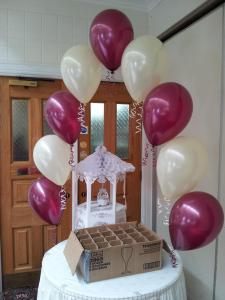 String Of Pearl Cake Arch in Burgundy and Ivory From cardiff Balloons